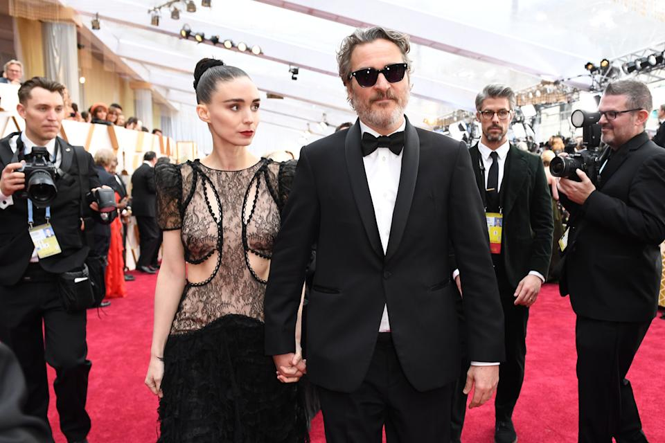 Joaquin Phoenix arriving with Rooney Mara at the 92nd Oscars on Sunday. (Photo: VALERIE MACON/AFP via Getty Images)