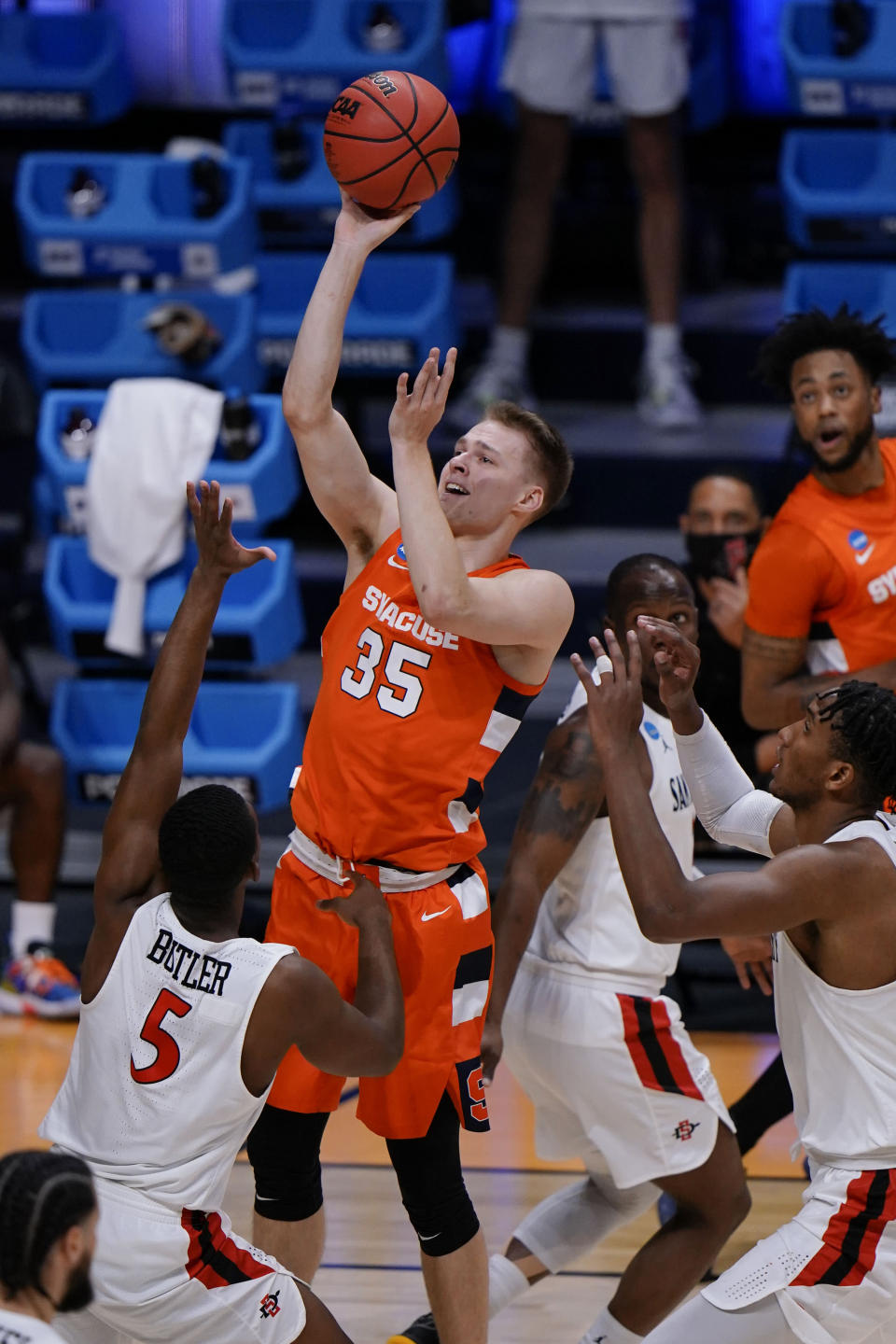 Syracuse guard Buddy Boeheim (35) shoots over San Diego State guard Lamont Butler (5) during the first half of a college basketball game in the first round of the NCAA tournament at Hinkle Fieldhouse in Indianapolis, Friday, March 19, 2021. (AP Photo/AJ Mast)