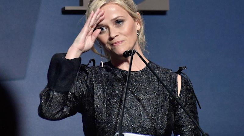 Actress Reese Witherspoon said Monday she was assaulted at age 16 by a director in one of several instances of sexual misconduct she has endured in her career.