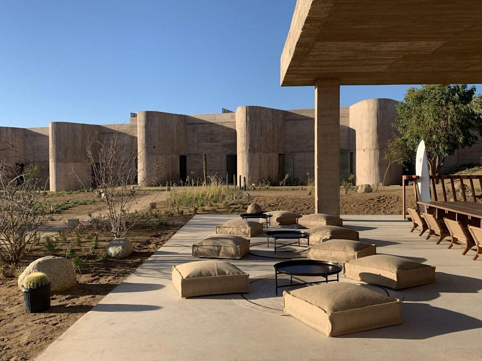 """<p>If unadorned concrete is your vibe, then you'll feel right at home at this mammoth, supremely austere, sun-soaked complex in Todos Santos on the Baja California Peninsula. With its 35 suites housed in a hulking Brutalist-inspired building designed by Ruben Valdez and Yashar Yektajo, a stay at <a href=""""https://www.paraderohotels.com/"""" rel=""""nofollow noopener"""" target=""""_blank"""" data-ylk=""""slk:Paradero Todos Santos"""" class=""""link rapid-noclick-resp"""">Paradero Todos Santos</a> leaves guests with a new respect for and meaningful relationship with Mother Nature.<br></p><p><a class=""""link rapid-noclick-resp"""" href=""""https://go.redirectingat.com?id=74968X1596630&url=https%3A%2F%2Fwww.tripadvisor.com%2FHotel_Review-g1636027-d23126069-Reviews-Paradero_Todos_Santos-El_Pescadero_Baja_California.html&sref=https%3A%2F%2Fwww.elledecor.com%2Flife-culture%2Fg36802095%2Fbest-new-hotels-in-the-world%2F"""" rel=""""nofollow noopener"""" target=""""_blank"""" data-ylk=""""slk:Book Now"""">Book Now</a></p>"""