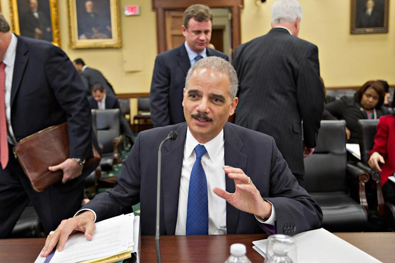 Attorney General Eric Holder arrives on Capitol Hill in Washington, Tuesday, Feb. 28, 2012, to testify before the House Commerce, Justice, Science, and Related Agencies hearing on the Justice Department's fiscal 2013 budget. (AP Photo/J. Scott Applewhite)
