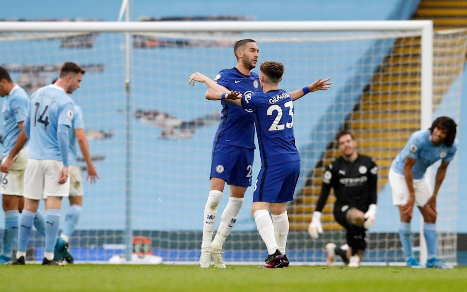 Chelsea's Hakim Ziyech celebrates scoring their first goal with Billy Gilmour - Reuters