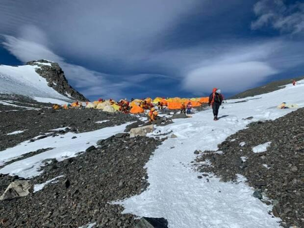 Kevin Walsh travelled with a team of 17 people. A total of 408 foreign climbers were issued permits to climb Everest this season, aided by several hundred Sherpa guides.