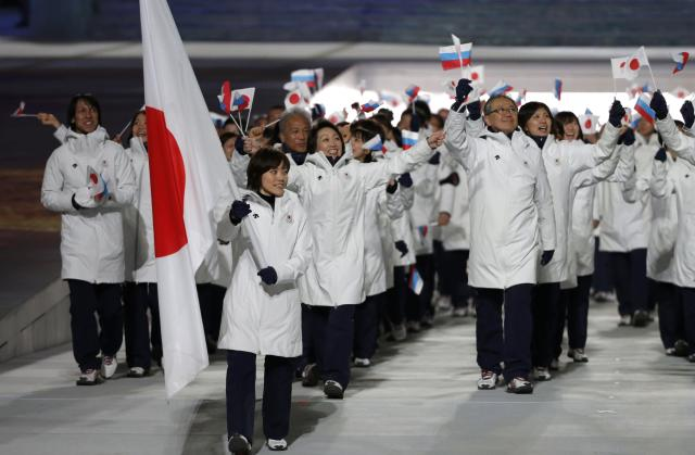 Japan's flag-bearer Ayumi Ogasawara leads her country's contingent during the athletes' parade at the opening ceremony of the 2014 Sochi Winter Olympics, February 7, 2014. REUTERS/Phil Noble (RUSSIA - Tags: OLYMPICS SPORT)