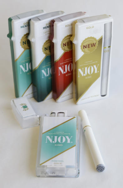 Several different versions of the NJOY electronic cigarettes are shown in Richmond, Va., Friday, March 22, 2013. Former U.S. Surgeon General Richard Carmona, who highlighted the dangers of secondhand smoke and supported a ban on all tobacco products, is joining the board of directors for NJOY Inc., the nation's leading electronic cigarette company — a move that could bring increased legitimacy to e-cigarettes as a viable alternative to traditional cigarettes. (AP Photo/Steve Helber)