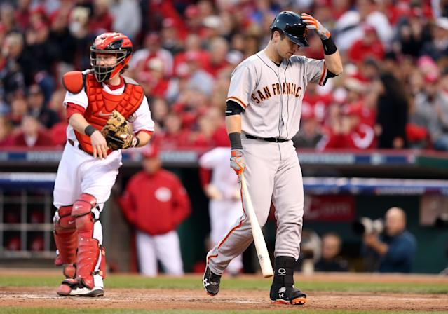 CINCINNATI, OH - OCTOBER 09: Buster Posey #28 of the San Francisco Giants reacts after striking out in the fourth inning as Ryan Hanigan #29 of the Cincinnati Reds throws the ball back to the pitcher in Game Three of the National League Division Series at the Great American Ball Park on October 9, 2012 in Cincinnati, Ohio. (Photo by Andy Lyons/Getty Images)