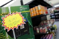 """A price of a power generator is seen in U.S. dollars at a """"bodegon"""" in Caracas"""