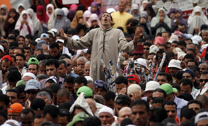 Thousands of Islamists attend Friday prayers before a rally in Tahrir Square to denounce the presidential candidacies of Hosni Mubarak-era officials, including that of his former spy chief in Cairo, Egypt, Friday, April 13, 2012. Supporters of the country's most influential political group, the Muslim Brotherhood, along with ultraconservative Salafis and other Islamists packed the capital's Tahrir Square, which was the epicenter of the uprising that ousted Mubarak a year ago. (AP Photo/Khalil Hamra)