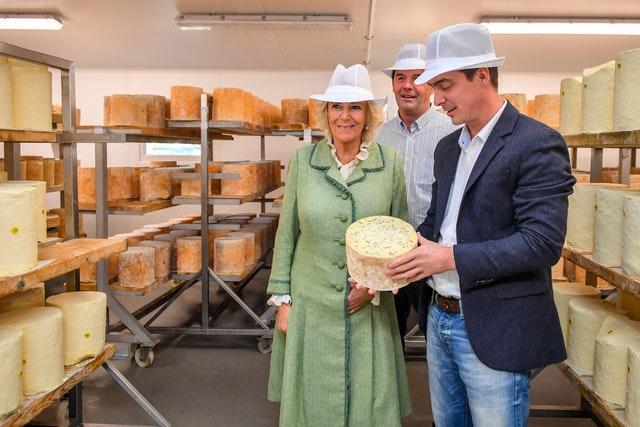 The Duchess of Cornwall is shown a blue cheese by Hugh Hadfield during her visit