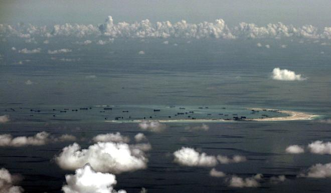 This photo, taken from a Philippine military plane, shows land reclamation by China on Mischief Reef in 2015. Photo: Pool via Reuters