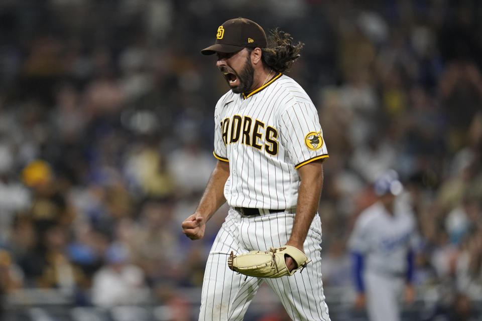 San Diego Padres relief pitcher Nabil Crismatt reacts after getting the third out during the thirteenth inning of a baseball game against the Los Angeles Dodgers, Wednesday, Aug. 25, 2021, in San Diego. (AP Photo/Gregory Bull)