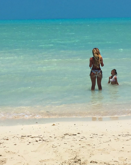 """<p>Kim listened in on her eldest daughter Brielle's conversation with Kaia: """"Brielle says. 'Kaia stand in the water with me, you get a way better tan that way.' Kaia replies, 'Count me in,'"""" Kim wrote. We're not sure a 3-year-old needs to be tanning, but who are we to judge? (Photo: <a href=""""https://www.instagram.com/p/BVArdj3Bqfg/"""" rel=""""nofollow noopener"""" target=""""_blank"""" data-ylk=""""slk:Kim Zolciak-Biermann via Instagram"""" class=""""link rapid-noclick-resp"""">Kim Zolciak-Biermann via Instagram</a>) </p>"""
