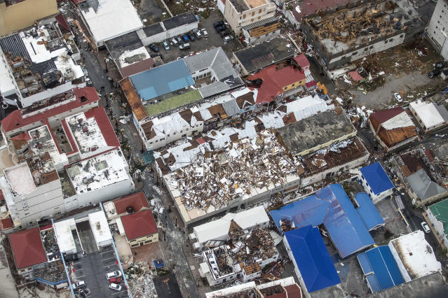 <p>Storm damage in the aftermath of Hurricane Irma, in St. Maarten. Irma cut a path of devastation across the northern Caribbean, leaving thousands homeless after destroying buildings and uprooting trees. (Photo: Gerben Van Es/Dutch Defense Ministry via AP) </p>