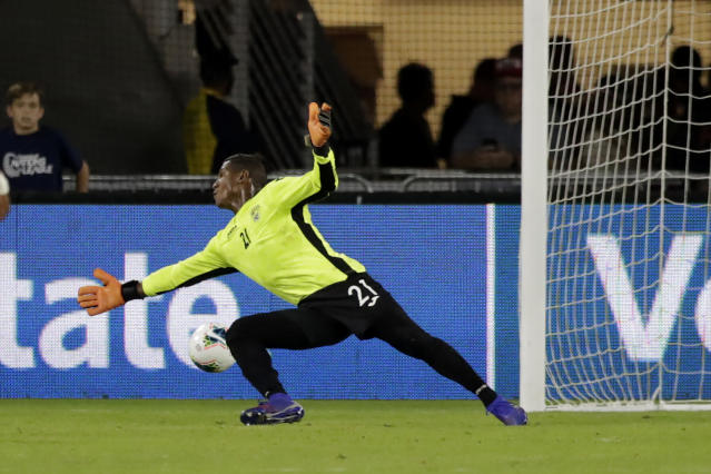 A shot by United States' Josh Sargent, not visible, gets by Cuba goalkeeper Nelson Johnston for a goal during the first half of a CONCACAF Nations League soccer match Friday, Oct. 11, 2019, in Washington. (AP Photo/Julio Cortez)