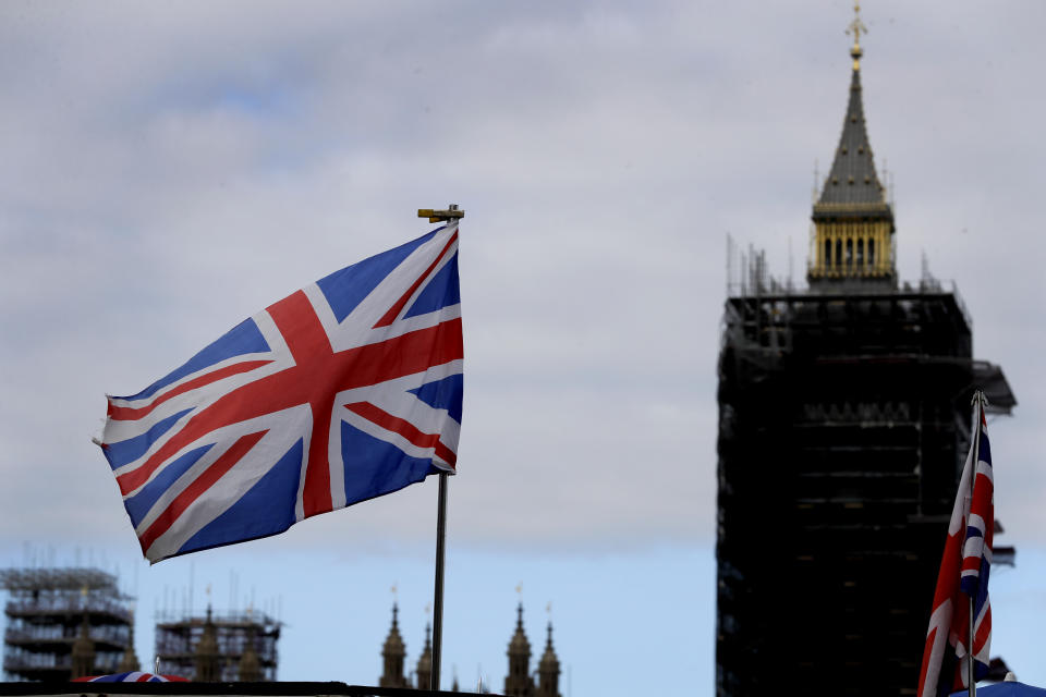 The Union flag flies above a souvenir stand in front of Big Ben in London. Photo: Kirsty Wigglesworth/AP