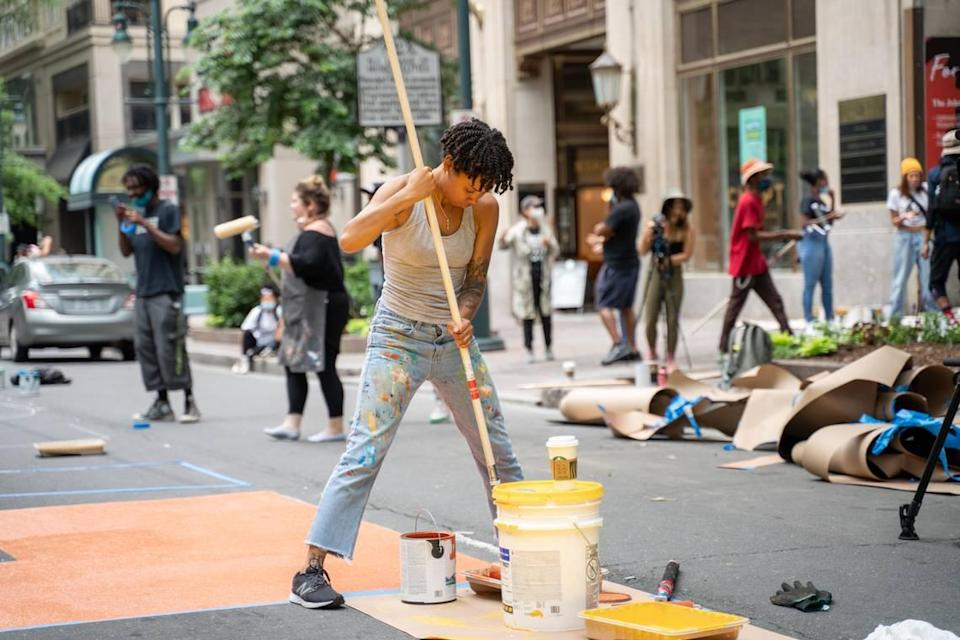 On June 9, Dakotah Aiyanna was uptown painting Black Lives Matter along Tryon Street with other artists in Charlotte.