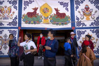 Tibetan visitors step into a courtyard at the Potala Palace in Lhasa in western China's Tibet Autonomous Region, as seen during a rare government-led tour of the region for foreign journalists, Tuesday, June 1, 2021. Long defined by its Buddhist culture, Tibet is facing a push for assimilation and political orthodoxy under China's ruling Communist Party. (AP Photo/Mark Schiefelbein)