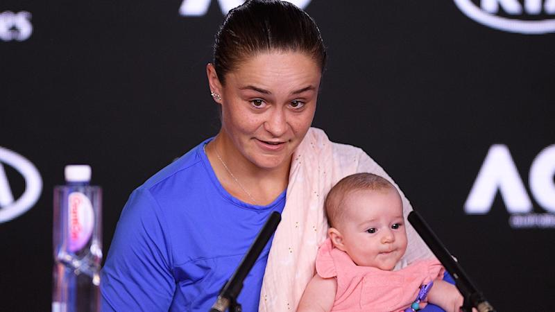 Ash Barty smiling with her niece at the Australian Open semi-final press conference.