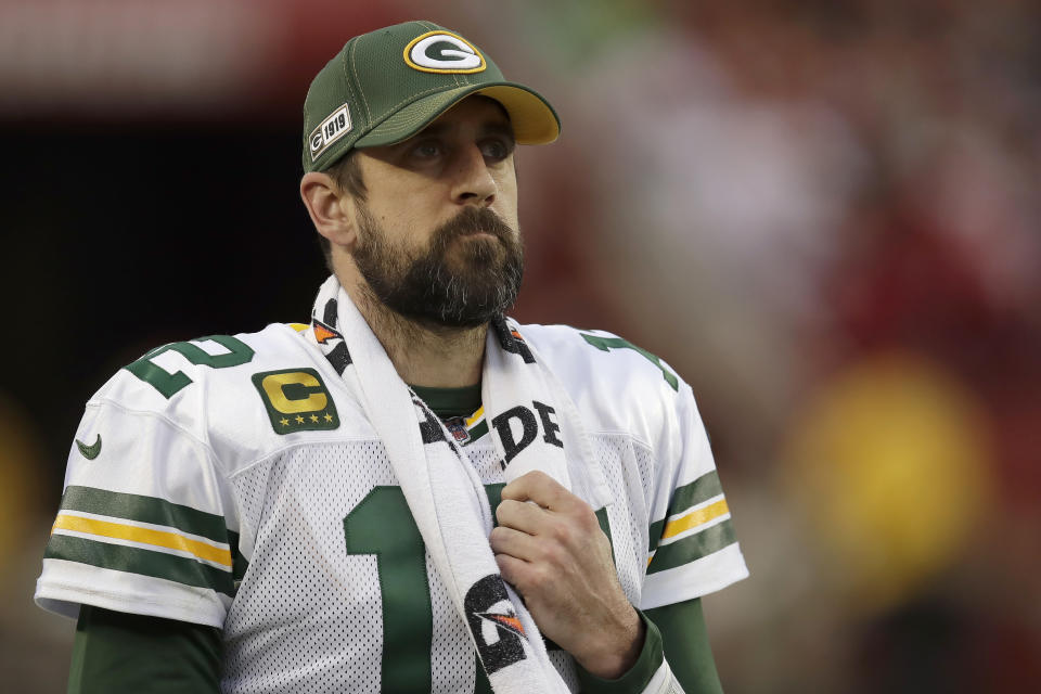 FILE - In this Jan. 19, 2020, file photo, Green Bay Packers quarterback Aaron Rodgers (12) watches from the sideline during the first half of the NFL NFC Championship football game against the San Francisco 49ers in Santa Clara, Calif.  Some players surely flourished and others most certainly floundered when the COVID-19 crisis forced teams to replace their regular offseason programs with virtual OTAs and videoconference. (AP Photo/Ben Margot, File)