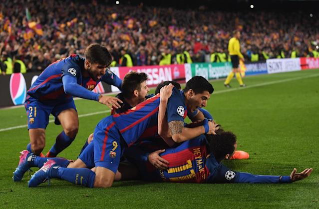 <p>Sergi Roberto of Barcelona (obscured) celebrates with team mates as he scores their sixth goal during the UEFA Champions League Round of 16 second leg match between FC Barcelona and Paris Saint-Germain at Camp Nou on March 8, 2017 in Barcelona, Spain. (Photo by Laurence Griffiths/Getty Images) </p>