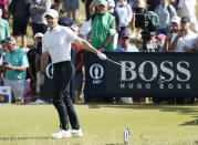 Northern Ireland's Rory McIlroy gestures with his club that the ball has gone left from the tee shot on the 7th during the first round British Open Golf Championship at Royal St George's golf course Sandwich, England, Thursday, July 15, 2021. (AP Photo/Peter Morrison)