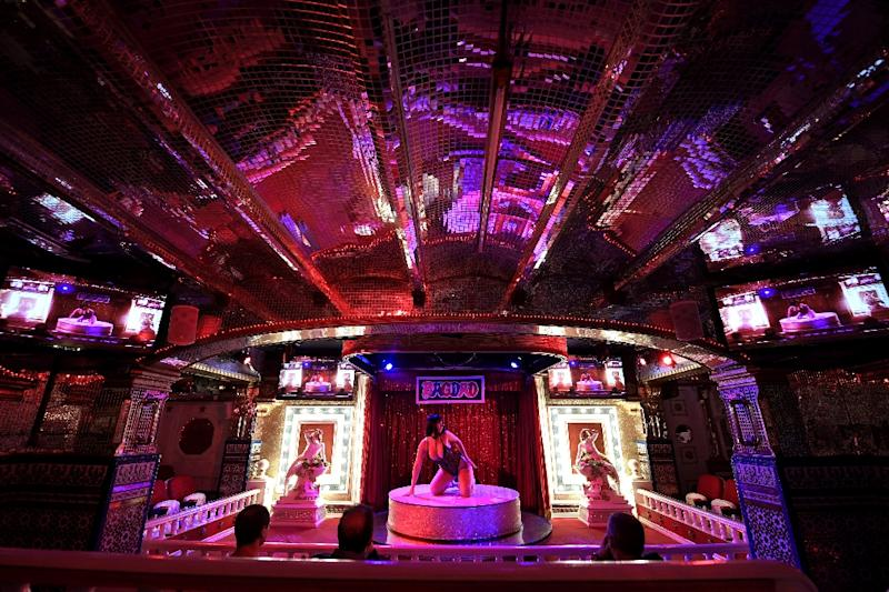 An actress performs on stage at Bagdad, a notorious Barcelona nightclub with pornographic shows, which is feeling the pinch amid a tourism slump (AFP Photo/GABRIEL BOUYS)