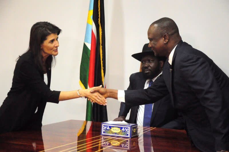 FILE PHOTO: U.S. Ambassador to the United Nations Nikki Haley greets South Sudan's First Vice President Taban Deng Gai next to South Sudan President Salva Kiir, in Juba