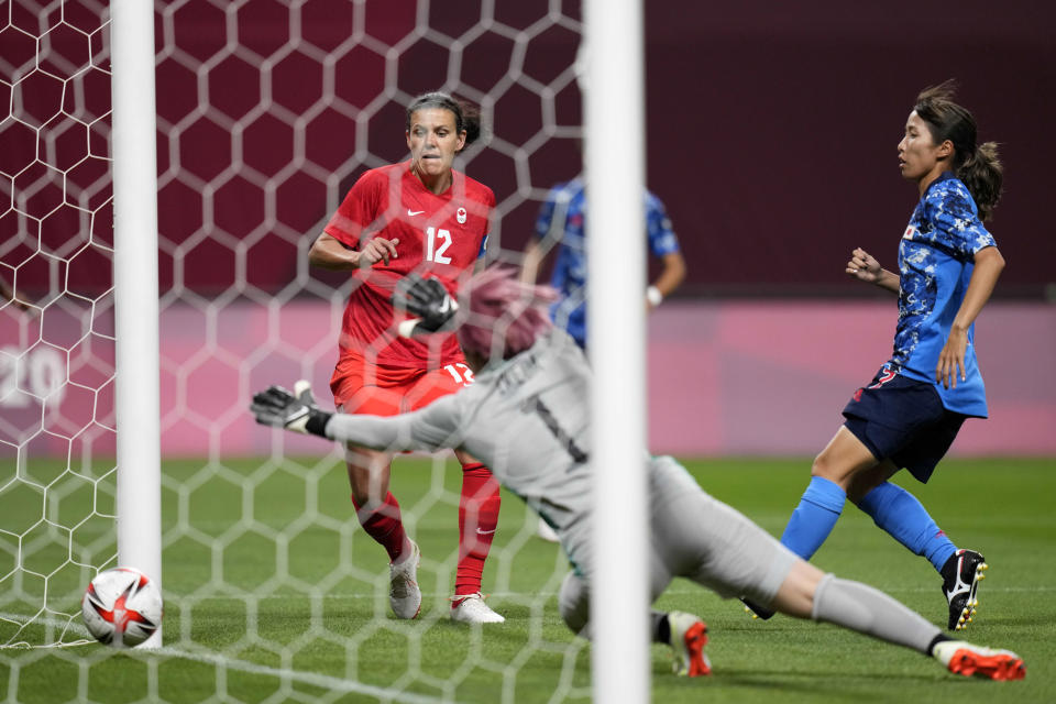 Canada's Christine Sinclair (12) scores a goal against Japan during a women's soccer match at the 2020 Summer Olympics, Wednesday, July 21, 2021, in Sapporo, Japan. (AP Photo/Silvia Izquierdo)