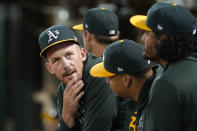 Oakland Athletics pitchers Chris Bassitt, from left, sits with Frankie Montas and Sean Manaea during the fourth inning of a baseball game against the Seattle Mariners in Oakland, Calif., Wednesday, Sept. 22, 2021. (AP Photo/Jeff Chiu)
