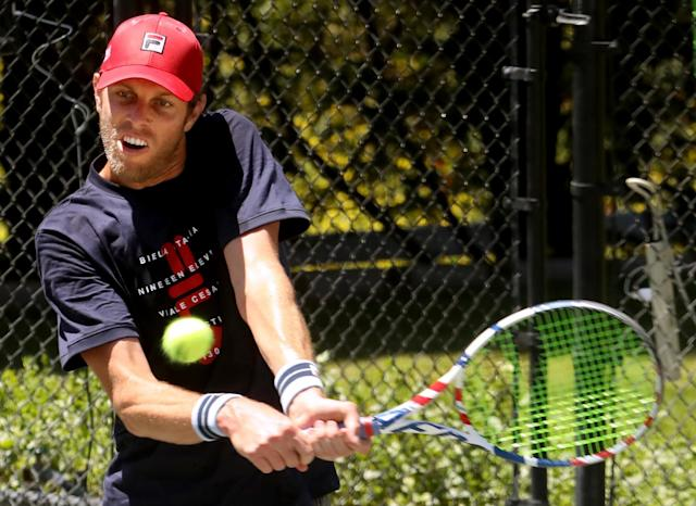 """Sam Querrey returns a shot from Brandon Holt during the final round of the Homecourt Advantage tournament on Sunday. <span class=""""copyright"""">(Genaro Molina / Los Angeles Times)</span>"""