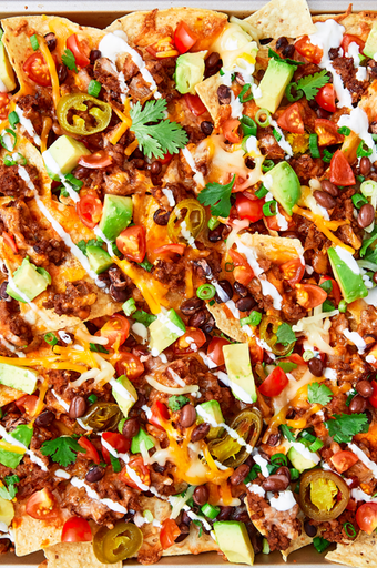 "<p>Is there anything more satisfying than a loaded tray of <a href=""https://www.delish.com/uk/cooking/recipes/a30386864/instant-pot-nachos-recipe/"" rel=""nofollow noopener"" target=""_blank"" data-ylk=""slk:nachos"" class=""link rapid-noclick-resp"">nachos</a>, still hot from the oven? They are the PERFECT weekend treat and they couldn't be any easier to make! This recipe is foolproof and sure to be delicious, but feel free to mix and match with your favourite ingredients.</p><p>Get the <a href=""https://www.delish.com/uk/cooking/recipes/a28895357/nachos-supreme-recipe/"" rel=""nofollow noopener"" target=""_blank"" data-ylk=""slk:Nachos Supreme"" class=""link rapid-noclick-resp"">Nachos Supreme</a> recipe.</p>"