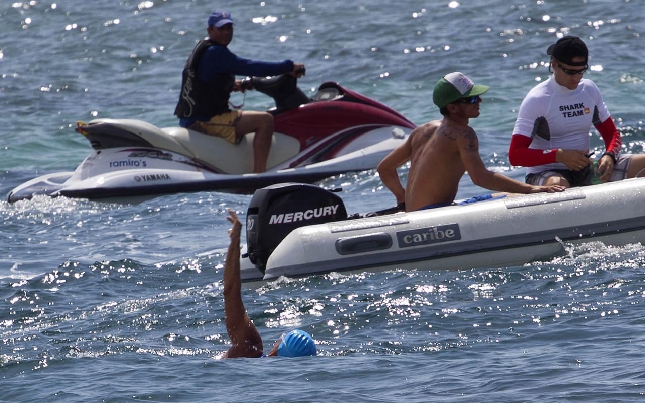 U.S. swimmer Diana Nyad, bottom, begins her swim to Florida from the waters off Havana, Cuba, Saturday, Aug. 18, 2012. Endurance athlete Nyad launched another bid Saturday to set an open-water record by swimming from Havana to the Florida Keys without a protective shark cage. (AP Photo/Ramon Espinosa)