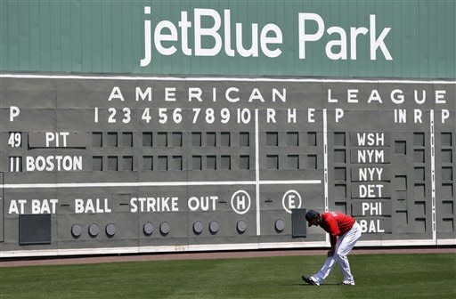 Boston Red Sox starting pitcher Clay Buchholz stretches in left field before an exhibition spring training baseball game against the Pittsburgh Pirates in Fort Myers, Fla., Saturday, March 23, 2013. (AP Photo/Elise Amendola)