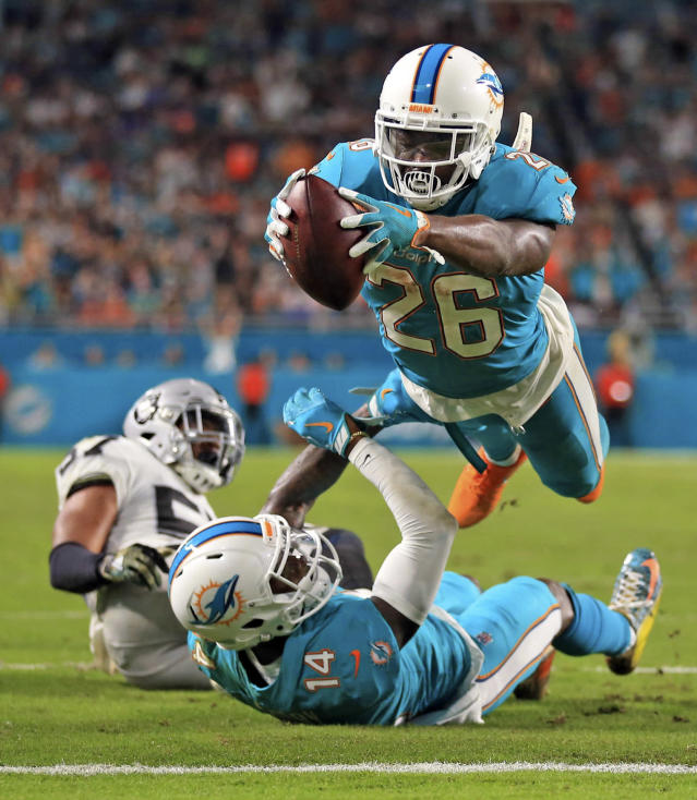 <p>Miami Dolphins running back Damien Williams (26) scores in the second quarter as the Miami Dolphins host the Oakland Raiders at Hard Rock Stadium on Sunday, November 5, 2017. </p>