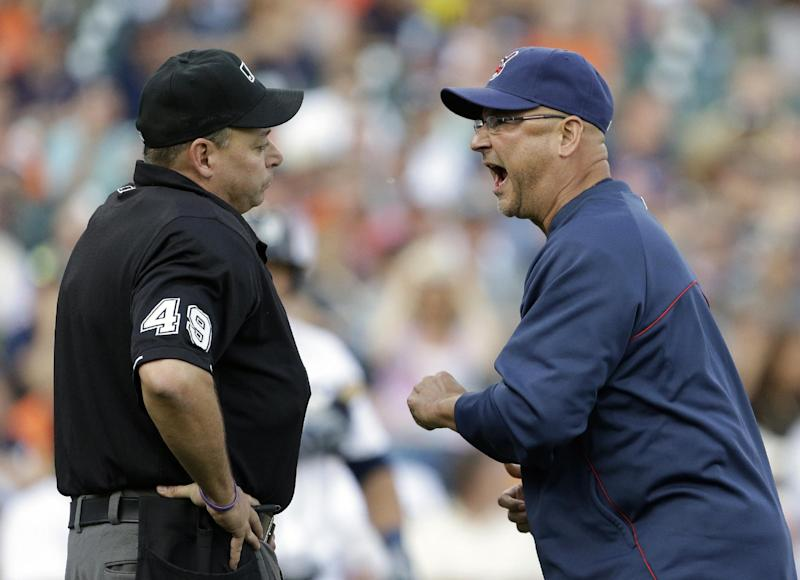 FILE - In this June 8, 2013 file photo, Cleveland Indians manager Terry Francona argues with home plate umpire Andy Fletcher during the eighth inning of a baseball game against the Detroit Tigers in Detroit. Francona was ejected from the game. With baseball's expanded replay rule this season, those colorful, saliva-trading tirades Bobby Cox and Lou Piniella made famous could very well be replaced by far more civilized behavior. (AP Photo/Carlos Osorio, File)