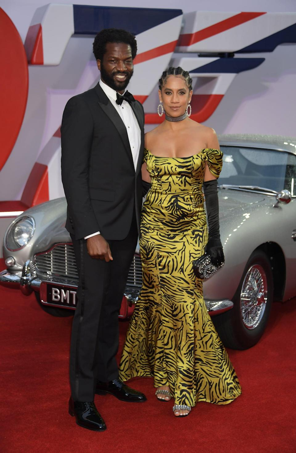 <p>Dinsu wore a black tuxedo, while Tipper wore a tiger-print gown with black opera gloves. </p>