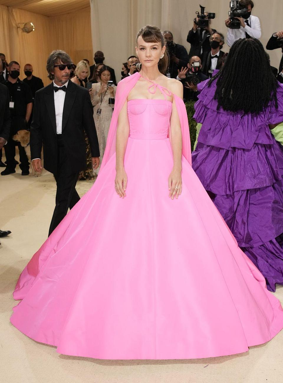 <p>Carey Mulligan arrived in a pink Valentino gown and cape. </p>