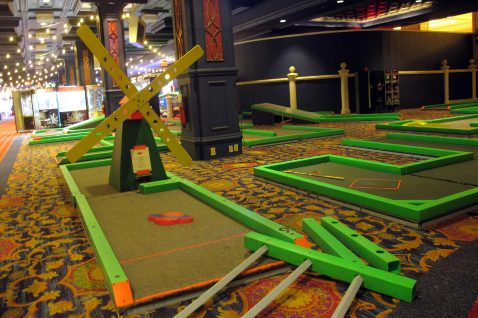 A day-glo mini-golf game sits inside the soon-to-open Lucky Snake arcade Wednesday, April 21, 2021, at the former Showboat casino in Atlantic City, N.J. Philadelphia developer Bart Blatstein is spending nearly $130 million on attractions at the former Atlantic City casino including an indoor water park; a retractible domed concert hall, a beer garden and a Boardwalk sun deck to increase family entertainment options in Atlantic City. (AP Photo/Wayne Parry)