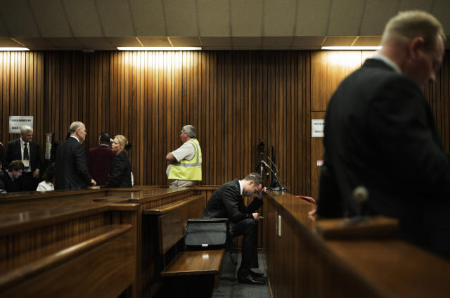 Oscar Pistorius, in the dock on the fourth day of his trial at the high court in Pretoria, South Africa, Thursday, March 6, 2014. Pistorius is charged with murder for the shooting death of his girlfriend, Reeva Steenkamp, on Valentines Day in 2013. (AP Photo/Marco Longari, Pool)