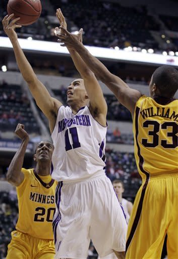 Northwestern guard Reggie Hearn (11) goes up for a shot against Minnesota forward Rodney Williams (33) and guard Austin Hollins (20) in the first half of an NCAA college basketball game at the first round of the Big Ten Conference tournament in Indianapolis, Thursday, March 8, 2012. (AP Photo/Michael Conroy)
