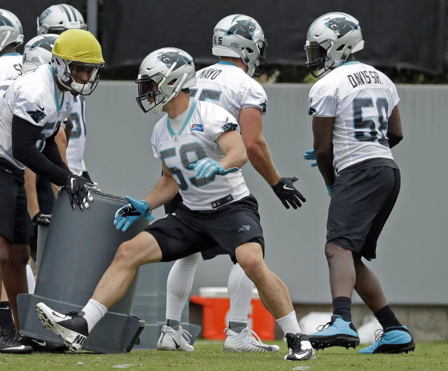 Carolina Panthers' Luke Kuechly (59) and Thomas Davis (58) runs a drill during the NFL football team's practice in Charlotte, N.C., Tuesday, June 12, 2018. (AP Photo/Chuck Burton)
