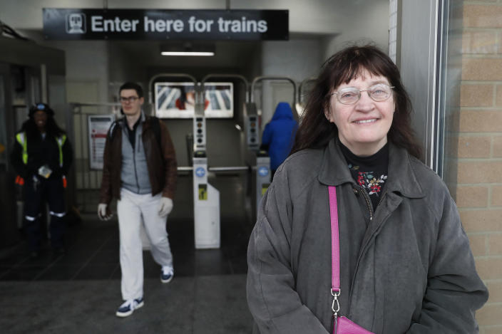 """Playwright Vicki Quade poses for a portrait at the North & Clybourn Streets """"L"""" station Monday, March 9, 2020, in Chicago. Older adults, those 60 and up like Quade should avoid crowds, cruises and long plane trips to avoid the coronavirus, advice that one public health official acknowledged won't be welcomed by many. Quade, 66, said she thinks most of the advice is extreme. """"Yes, be a bit more cautious, wash your hands and if you're not feeling good, stay inside,"""" """"I'm not that worried. Perhaps I should be but I think we have to continue just living our lives,"""" Quade said. (AP Photo/Charles Rex Arbogast)"""