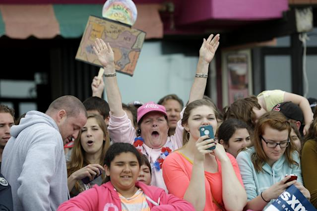 Peg Allen, of Franklinville, N.J., with arms raised, watches a live performance by musical group Fun at the Seaside Heights boardwalk, Friday, May 24, 2013, in Seaside Heights, N.J. New Jersey Gov. Chris Christie cut a ribbon to symbolically reopen the state's shore for the summer season, seven months after being devastated by Superstorm Sandy. Several beach communities have annual beach ribbon cuttings, announcing they are back in business. But this year's ceremonies are more poignant seven months after a storm that did an estimated $37 billion of damage in the state. (AP Photo/Julio Cortez)