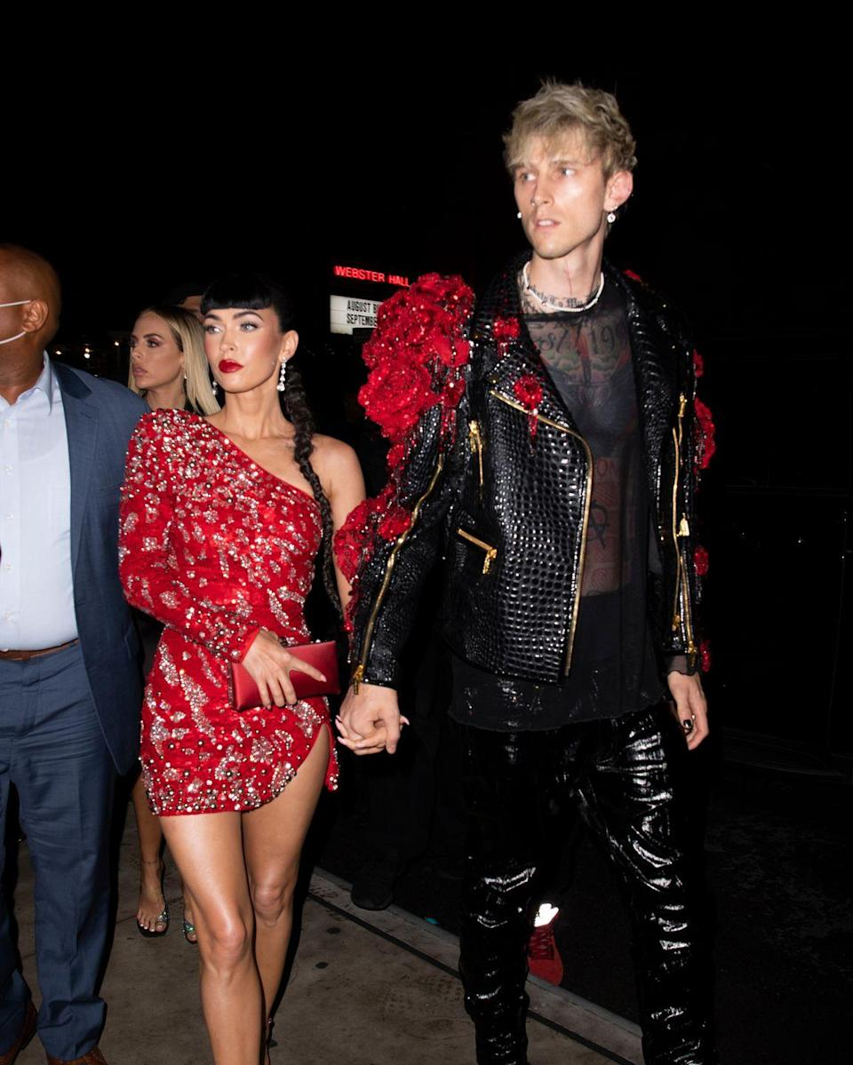 <p>Fox changed into a one-sleeved mini dress and was joined by boyfriend Machine Gun Kelly for the after parties.</p>