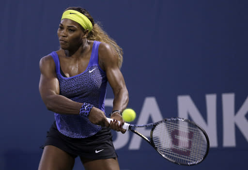Serena Williams returns the ball to Ana Ivanovic, from Serbia, during the first set of their match in the Bank of the West Classic tennis tournament in Stanford, Calif., Friday, Aug. 1, 2014. (AP Photo/Jeff Chiu)