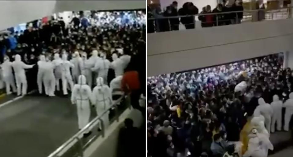 Scenes of large crowds at Shanghai International Airport being barricaded by human workers in hazmat suits