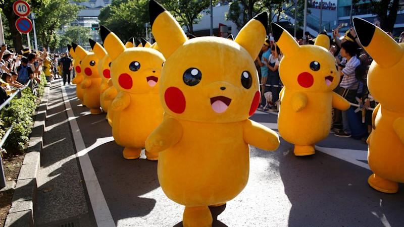 Performers wearing Pokemon's character Pikachu costumes take part in a parade in Yokohama