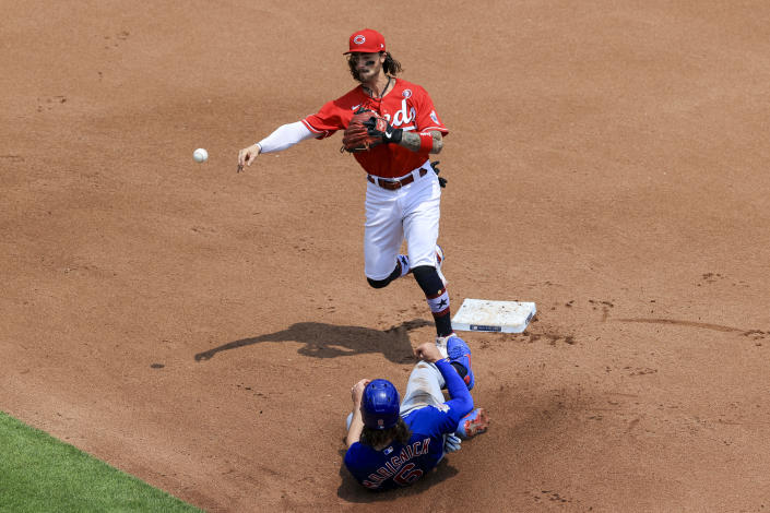 Cincinnati Reds' Jonathan India, top, forces out Chicago Cubs' Jake Marisnick, bottom, at second base as he turns a double play during the fourth inning of a baseball game in Cincinnati, Sunday, July 4, 2021. (AP Photo/Aaron Doster)