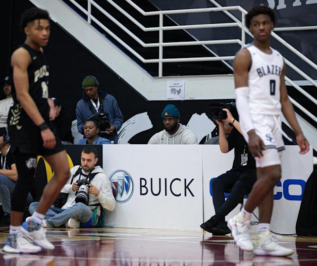 LeBron James looks on during Sierra Canyon's loss to Paul VI Catholic High School on Monday. (Credit: Jon Lopez/Hoophall Classic)