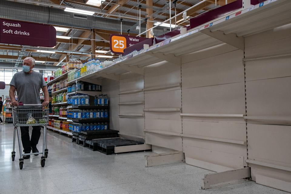 LONDON, ENGLAND - SEPTEMBER 19: Empty shelves that usually stock bottled water at Sainsbury's supermarket, Greenwich Peninsular, on September 19, 2021 in London, England. Gaps in supermarket shelves have appeared more frequently as a shortage of lorry drivers disrupted supply chains. Now, rising energy prices have disrupted the production of C02, a gas critical to the production and transport of meat, bread, beer and more. (Photo by Chris J Ratcliffe/Getty Images )